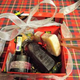 Festive gift box, holiday tin, or cylinder for muth jar honey with packing confetti, bow and optional card.